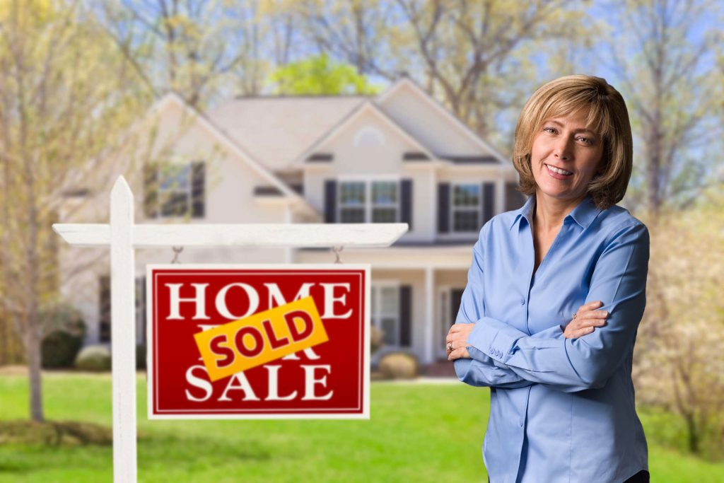 image of home with sold sign
