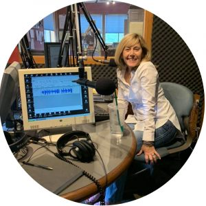 Photo of Lea Chitwood in the KOHI AM 1600 studio for her show Chit-Chat
